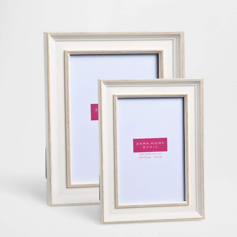White frame with antique finish