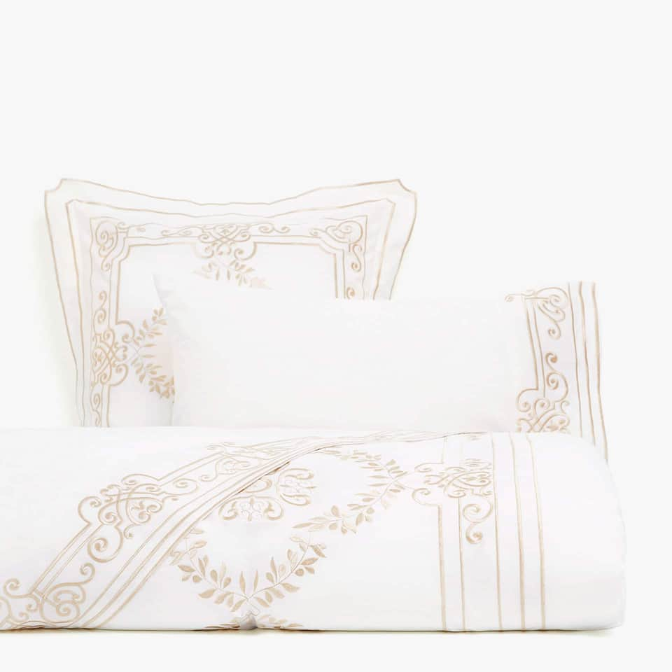 White duvet cover with gold embroidery
