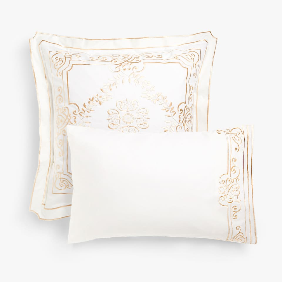 Pillow case with gold embroidery