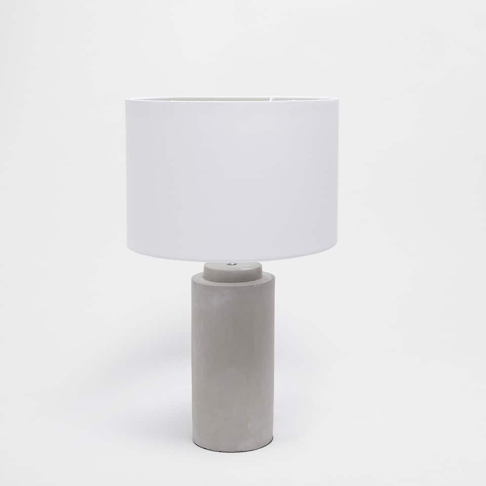 Lamp with a cement base