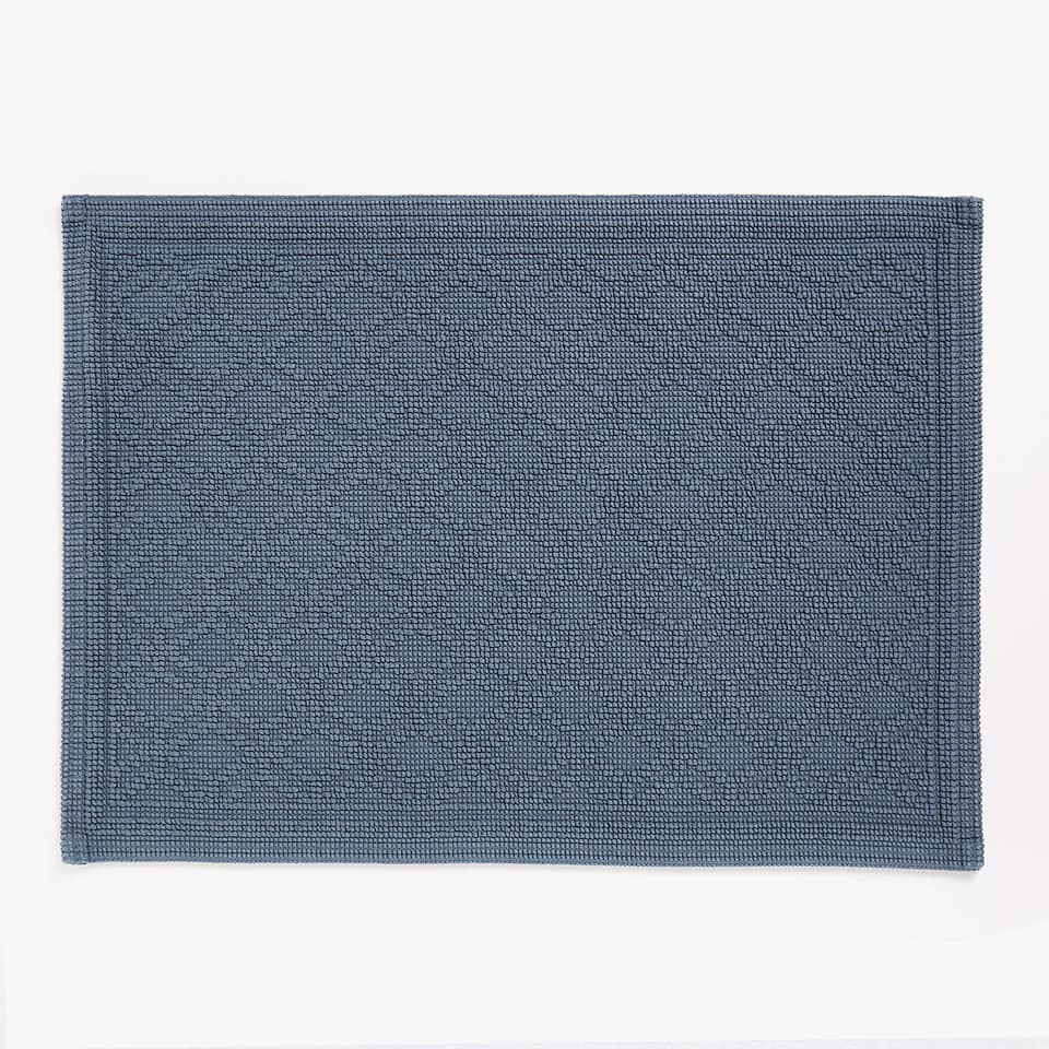 COTTON BATH MAT WITH ANGLES MOTIF