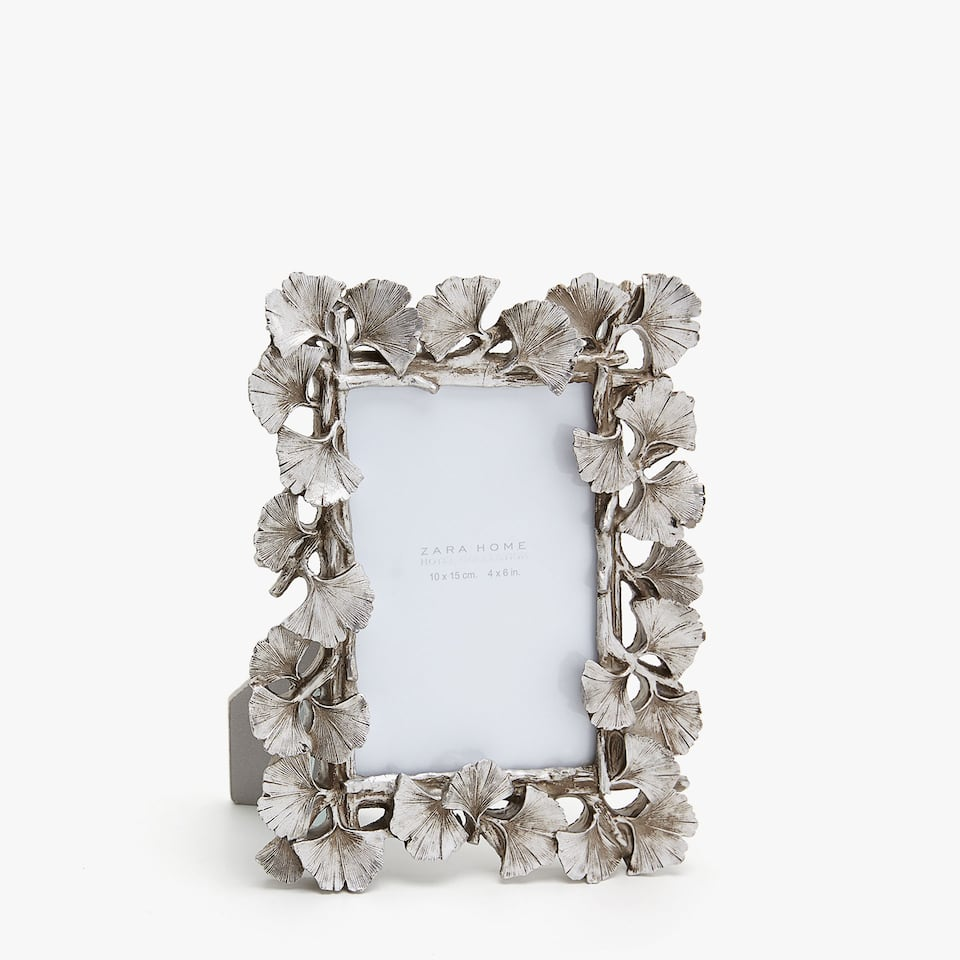 SILVER FRAME WITH LEAF DESIGN