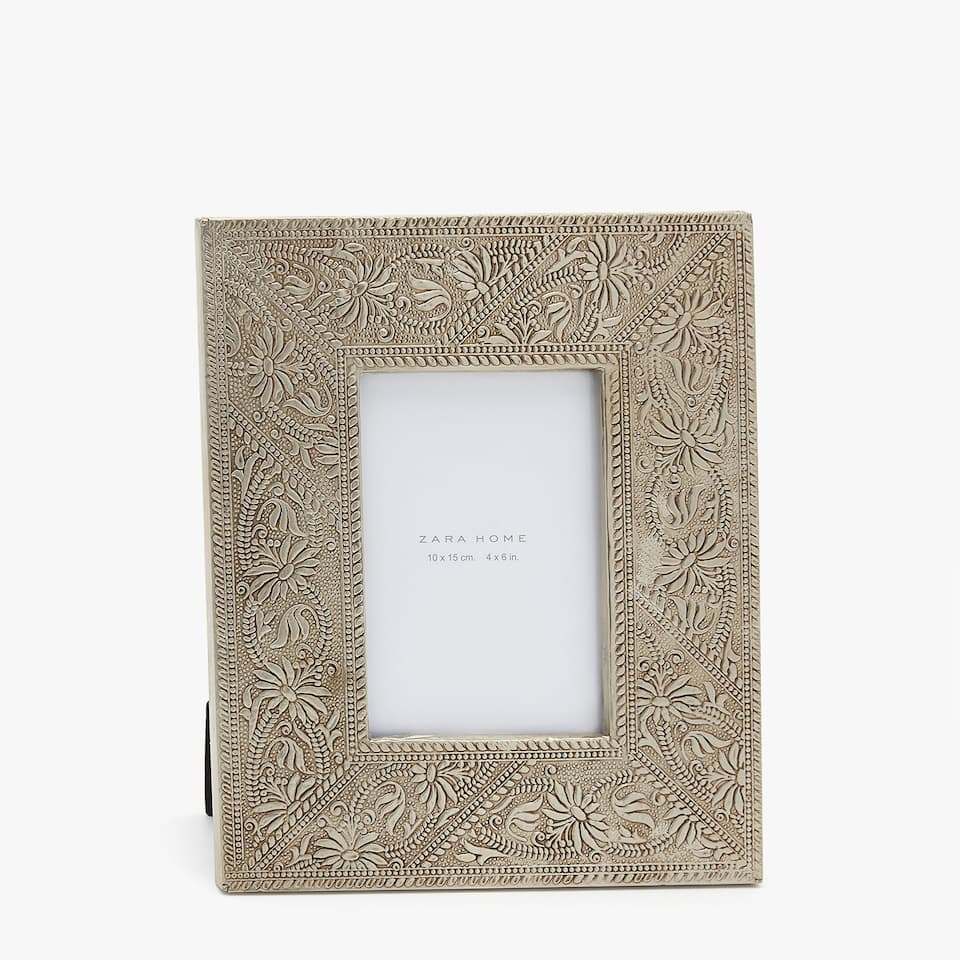 SILVER FRAME WITH RAISED FLORAL DESIGN