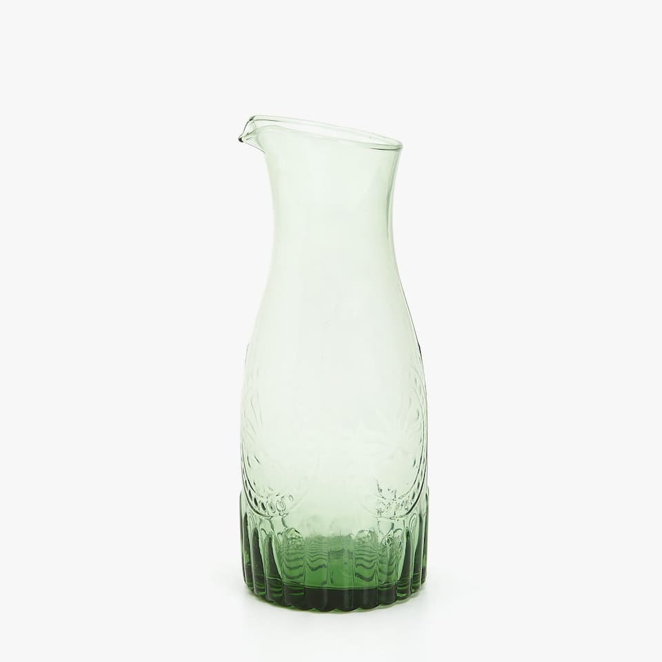 GLASS PITCHER WITH RAISED DESIGN
