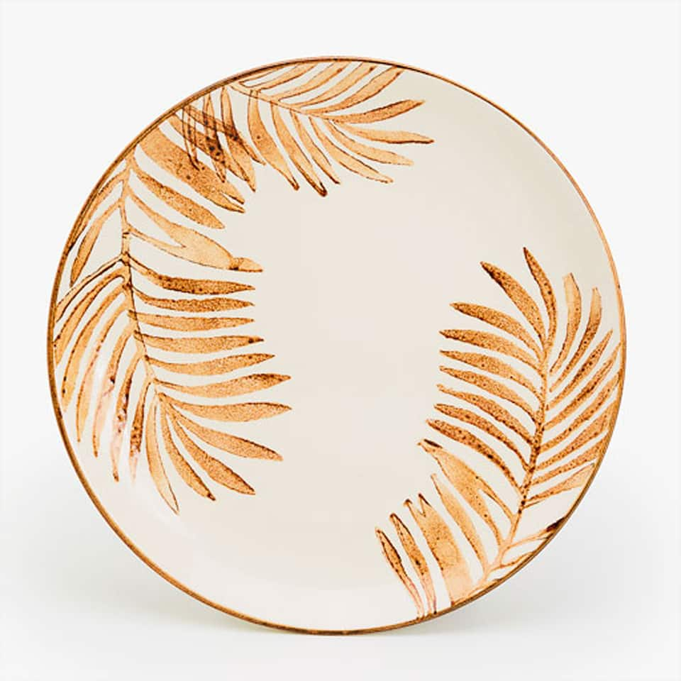 ROUND SERVING DISH WITH PALM TREE MOTIF