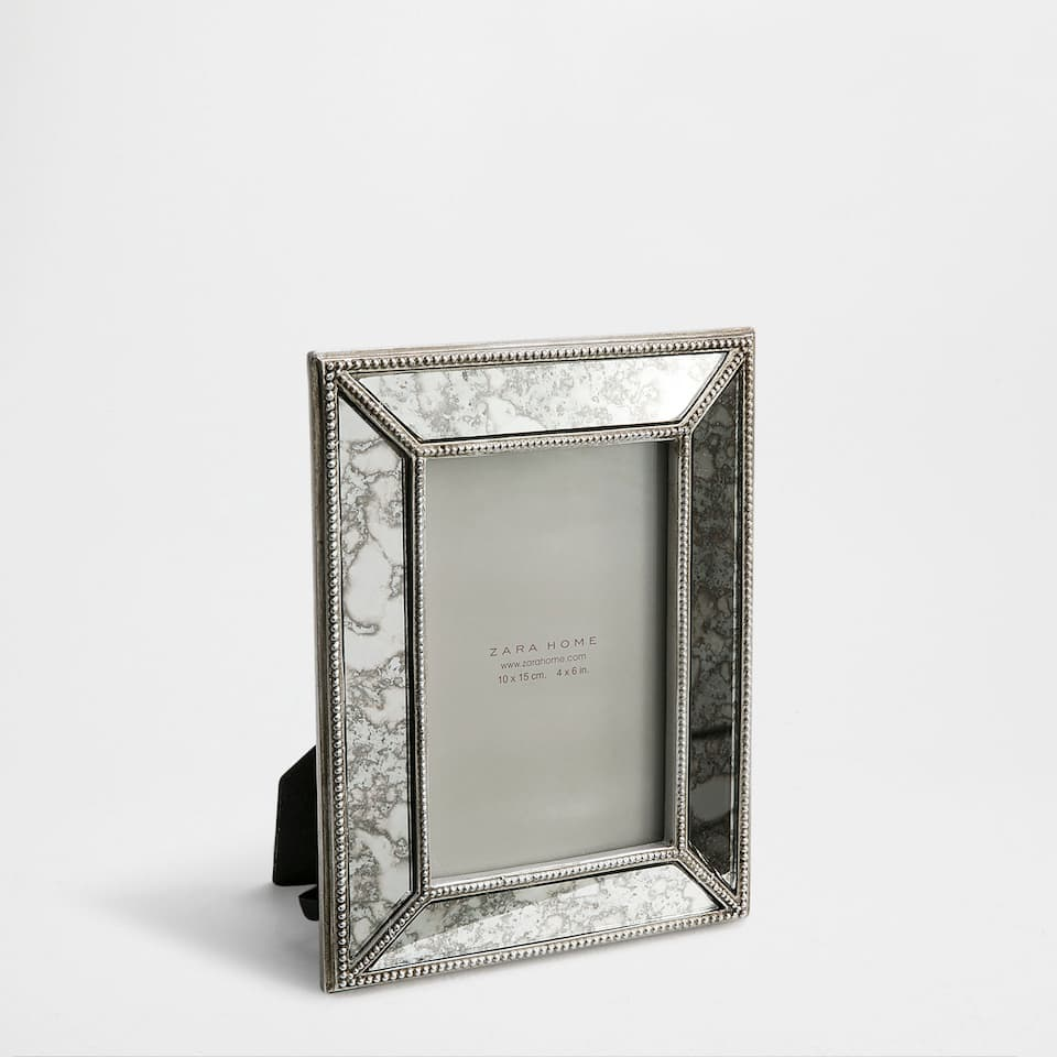 Mirrored antique-finish frame