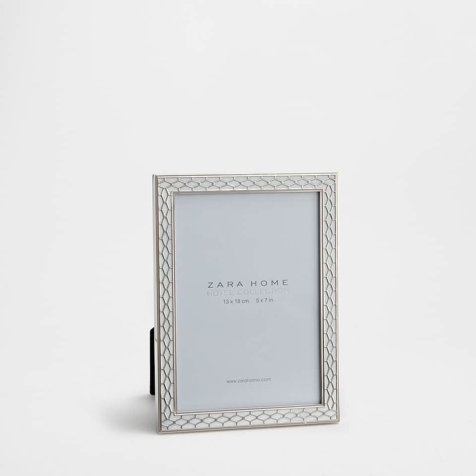 Metal mesh frame with black detail