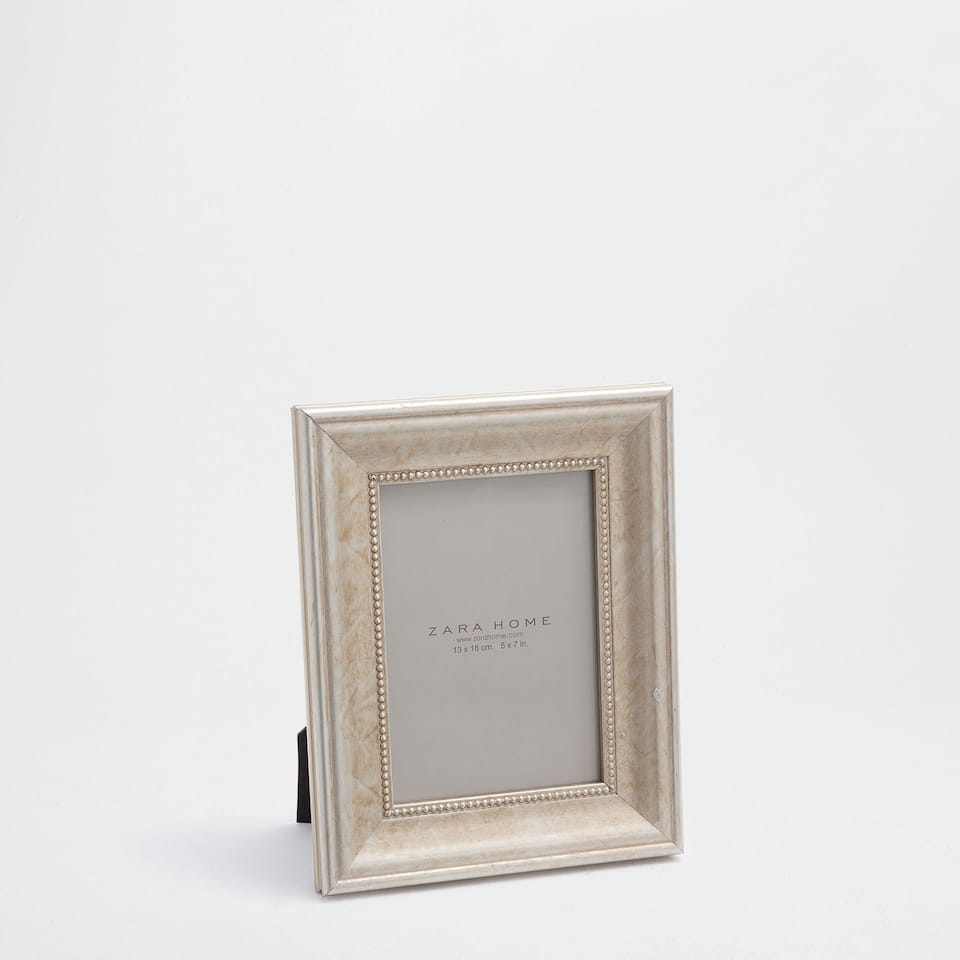 Champagne-coloured dotted frame