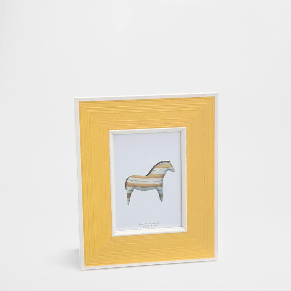 Yellow and white wooden frame