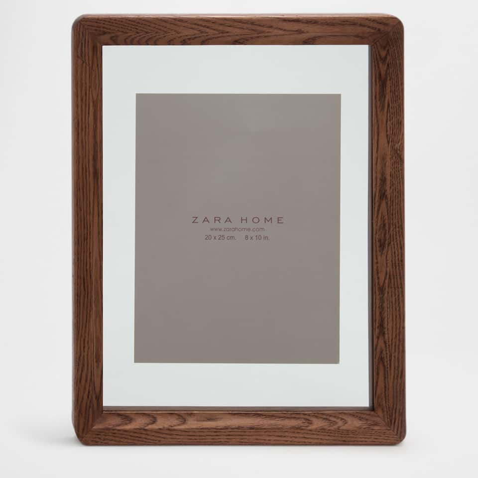 Dark wooden wall frame