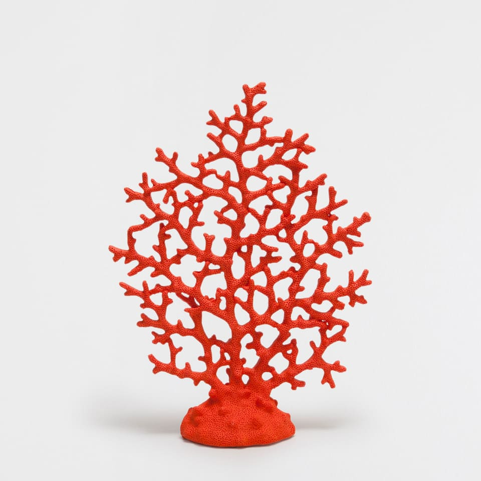Red coral-shaped decorative figure
