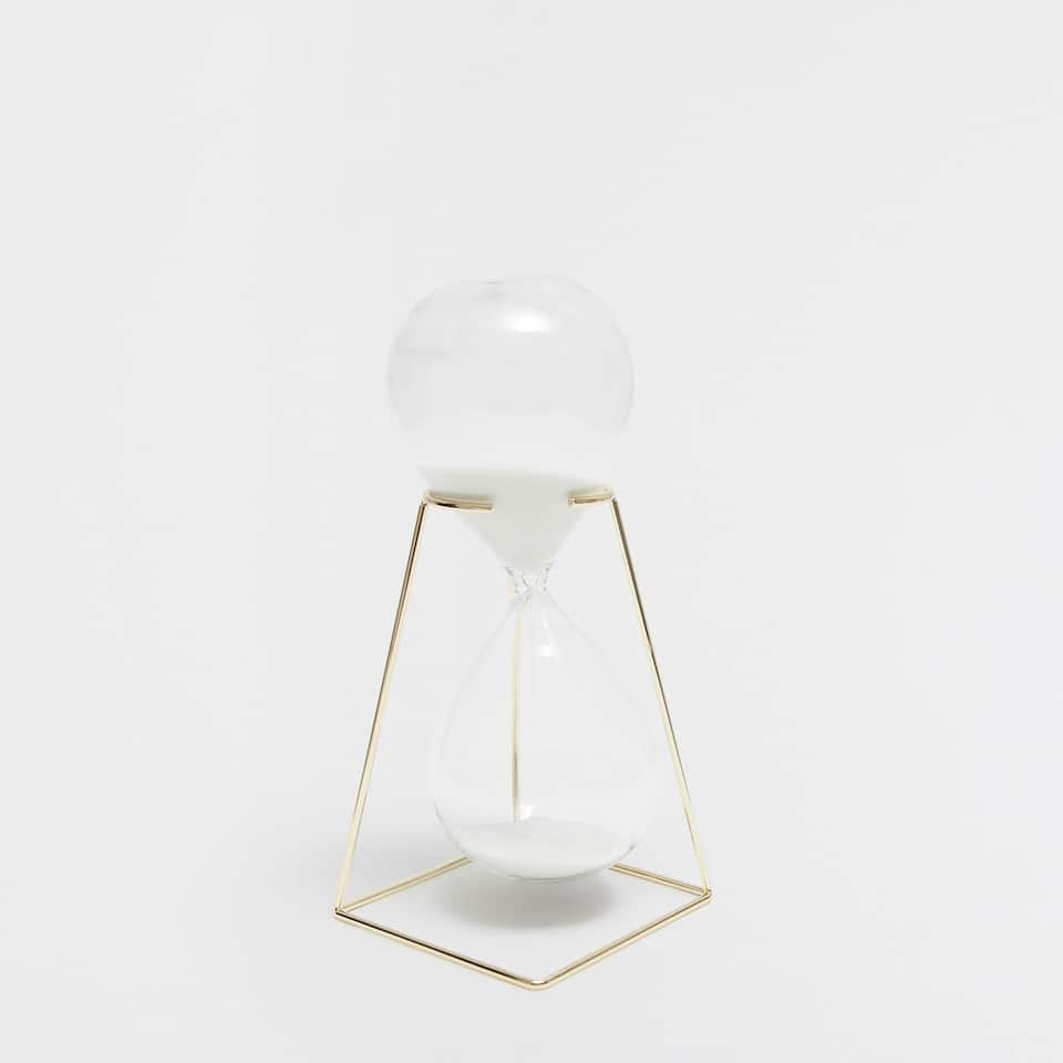 Hourglass with a gold metallic structure
