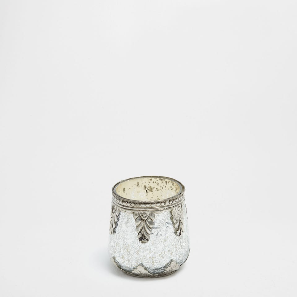 Silver glass and silver candle