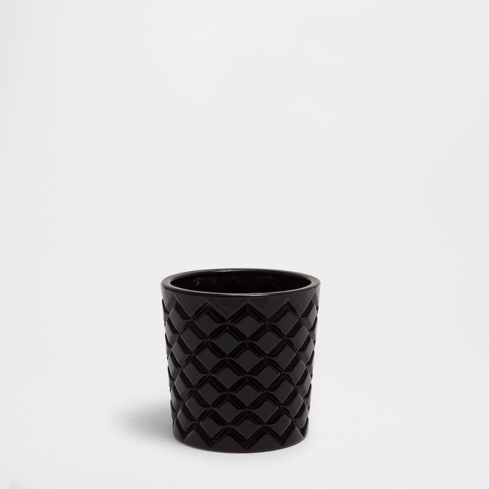 THICK BLACK GLASS TEALIGHT HOLDER WITH A RAISED DESIGN