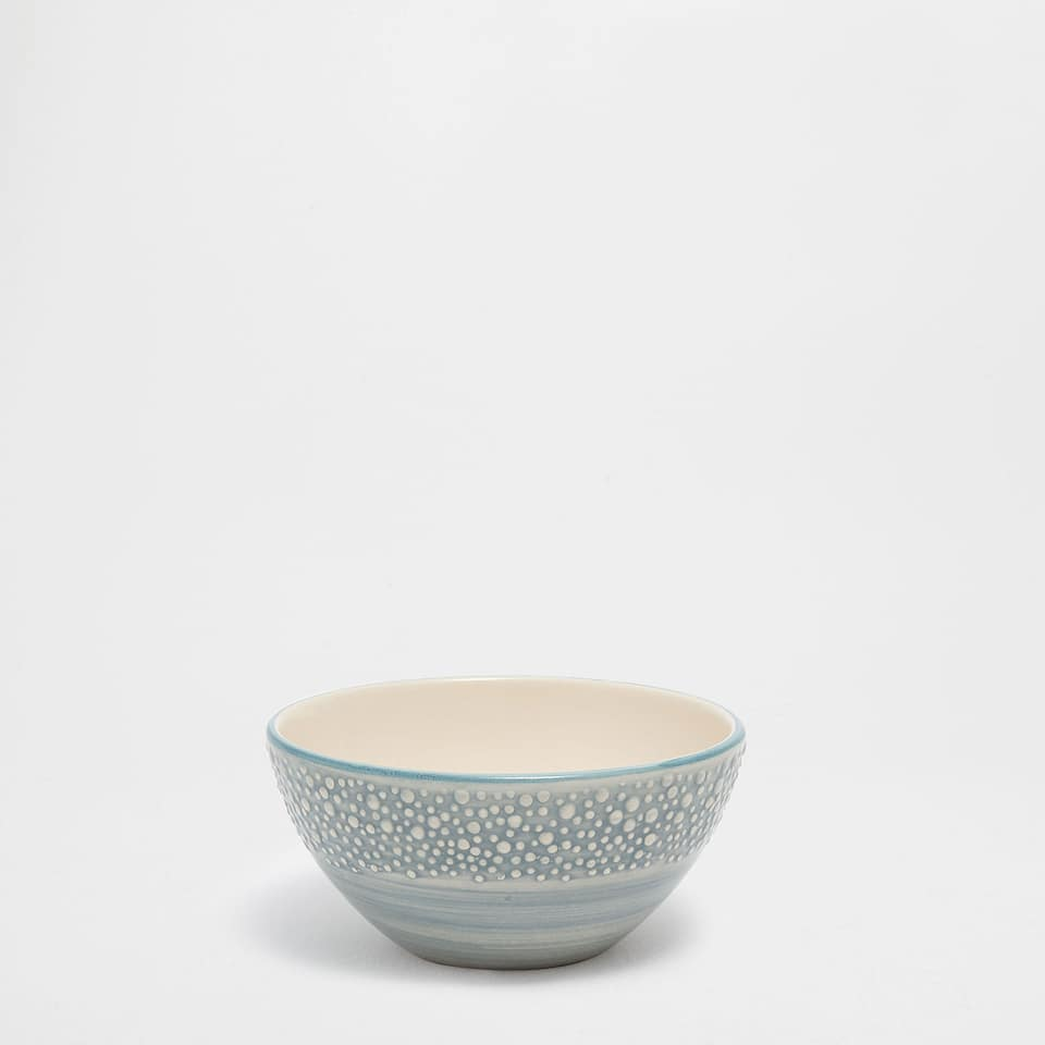 Earthenware bowl with a raised marine design