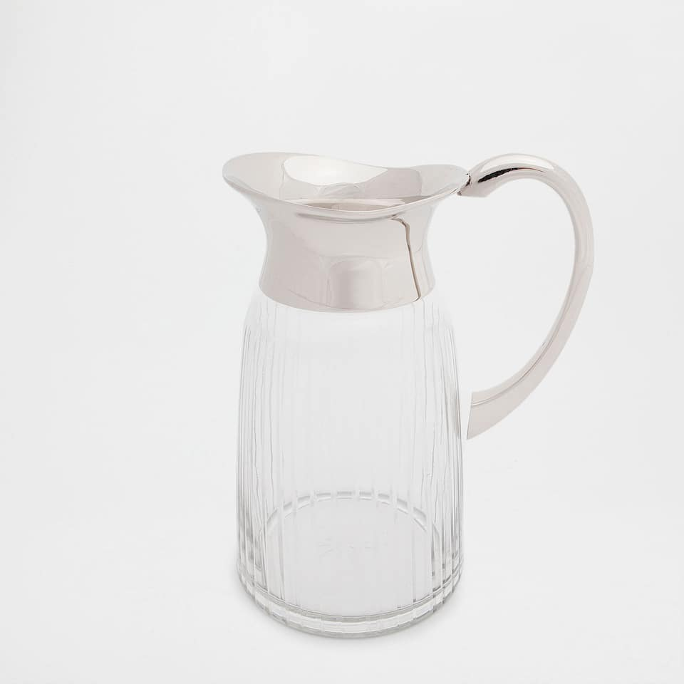 Raised-design glass jug