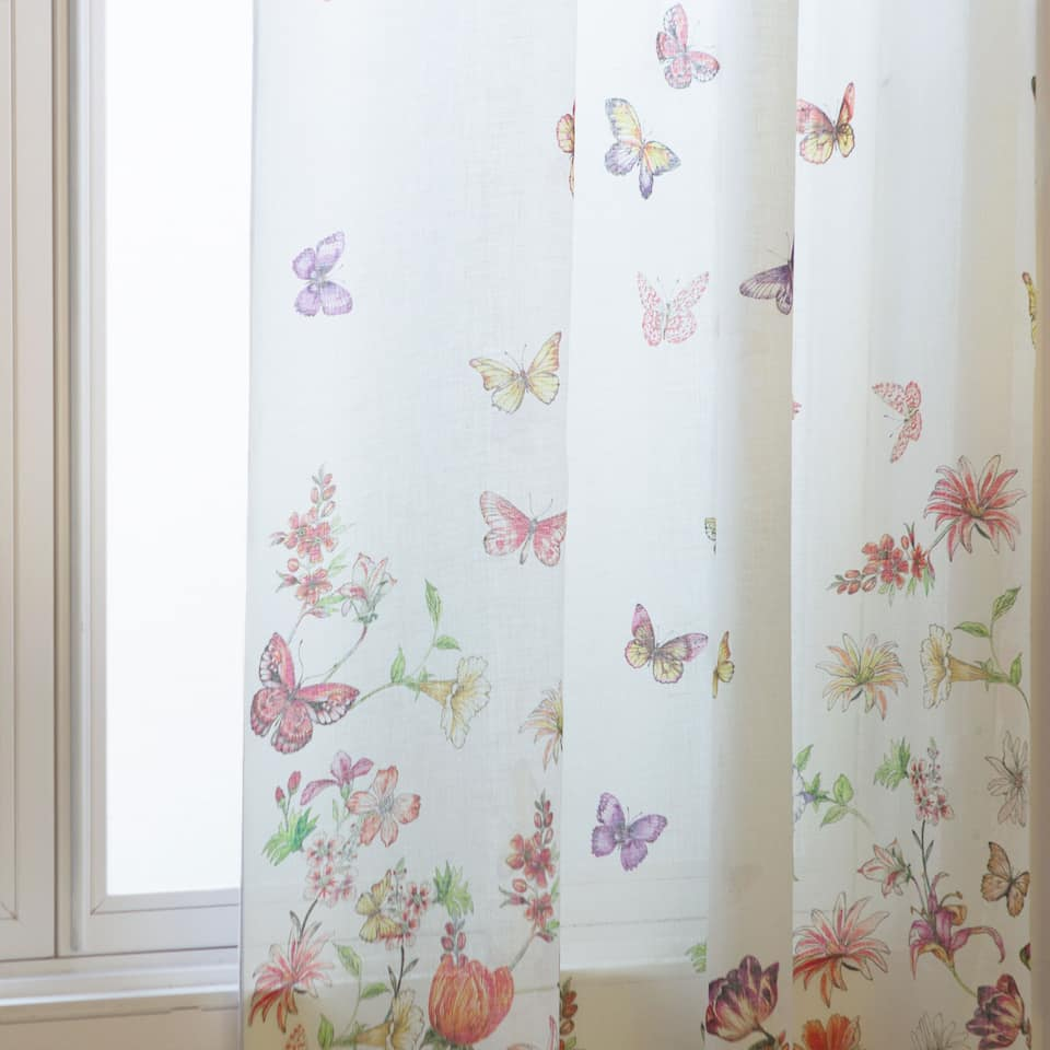 Curtain with a colourful floral and butterfly print