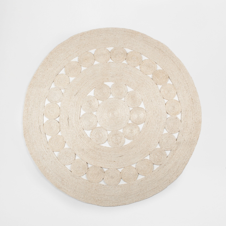 Natural-coloured round jute rug