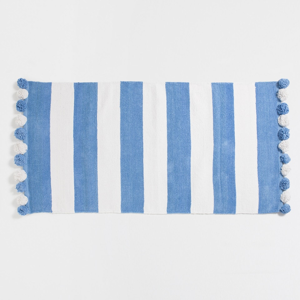 Blue striped rug with pompoms