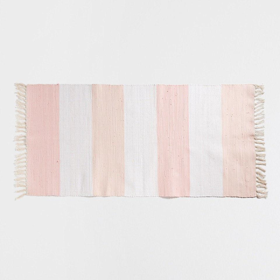 Pink and beige striped rug