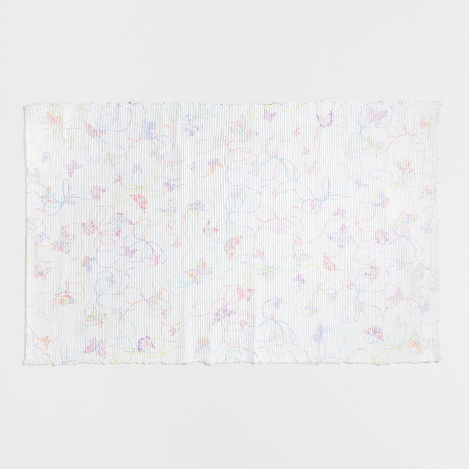 Butterflies and bows print rug