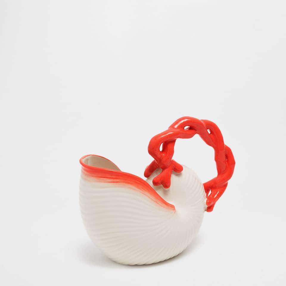 Snail-shaped earthenware jug