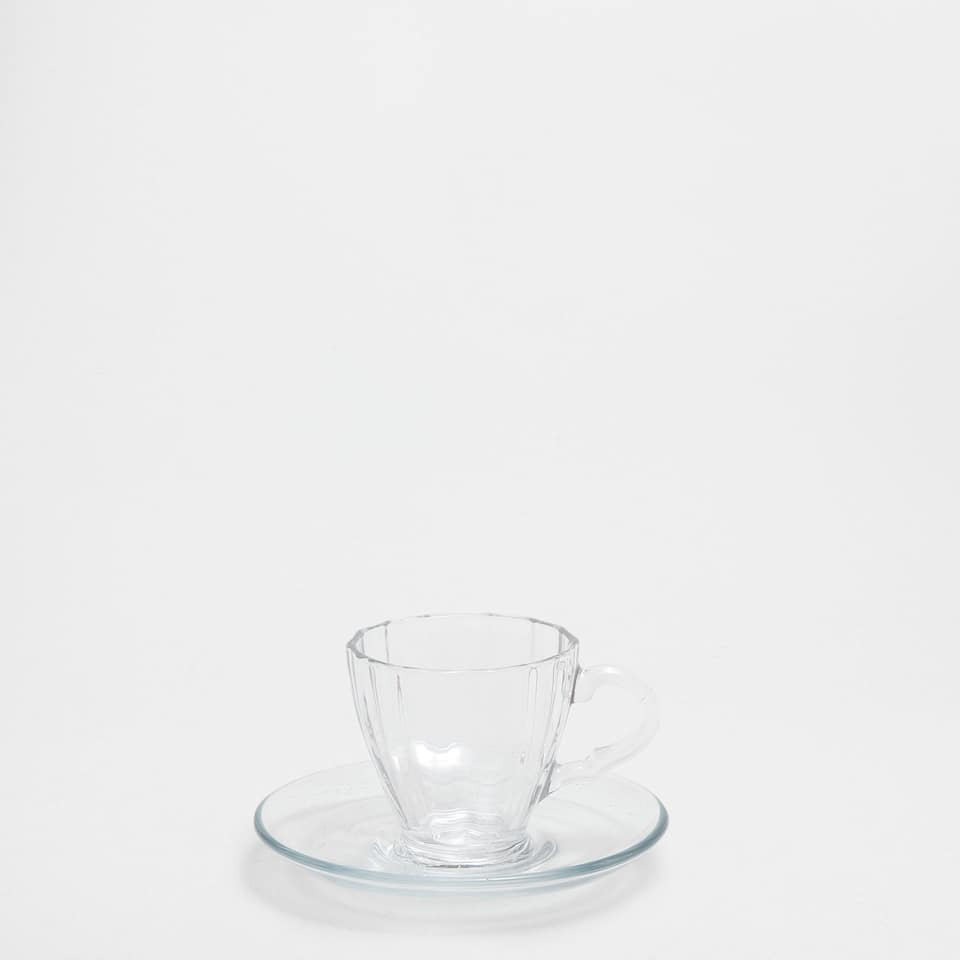 Transparent glass coffee cup and saucer
