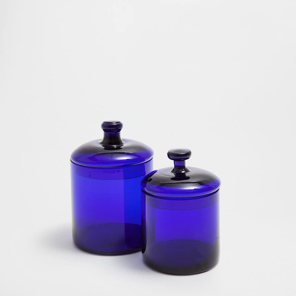Glass jar with blue lid