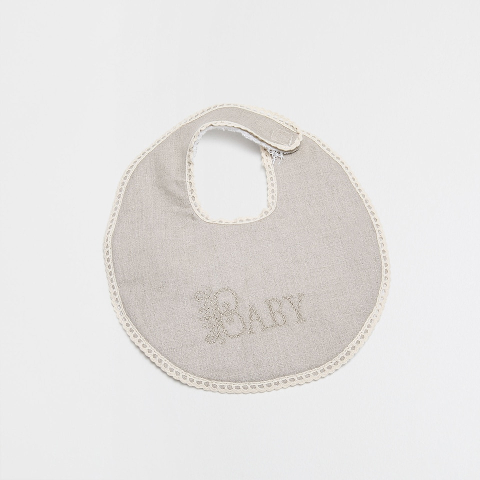 Baby embroidered linen and cotton bib