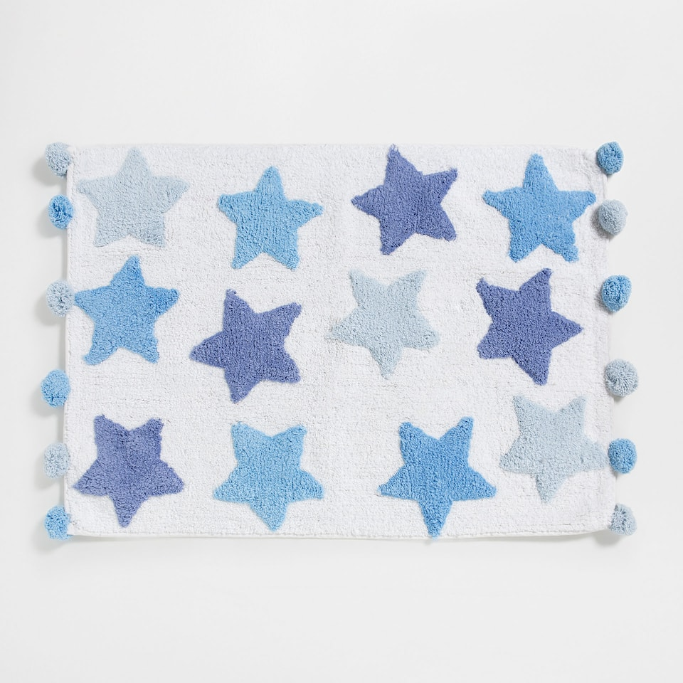 Stars and pompoms bath mat
