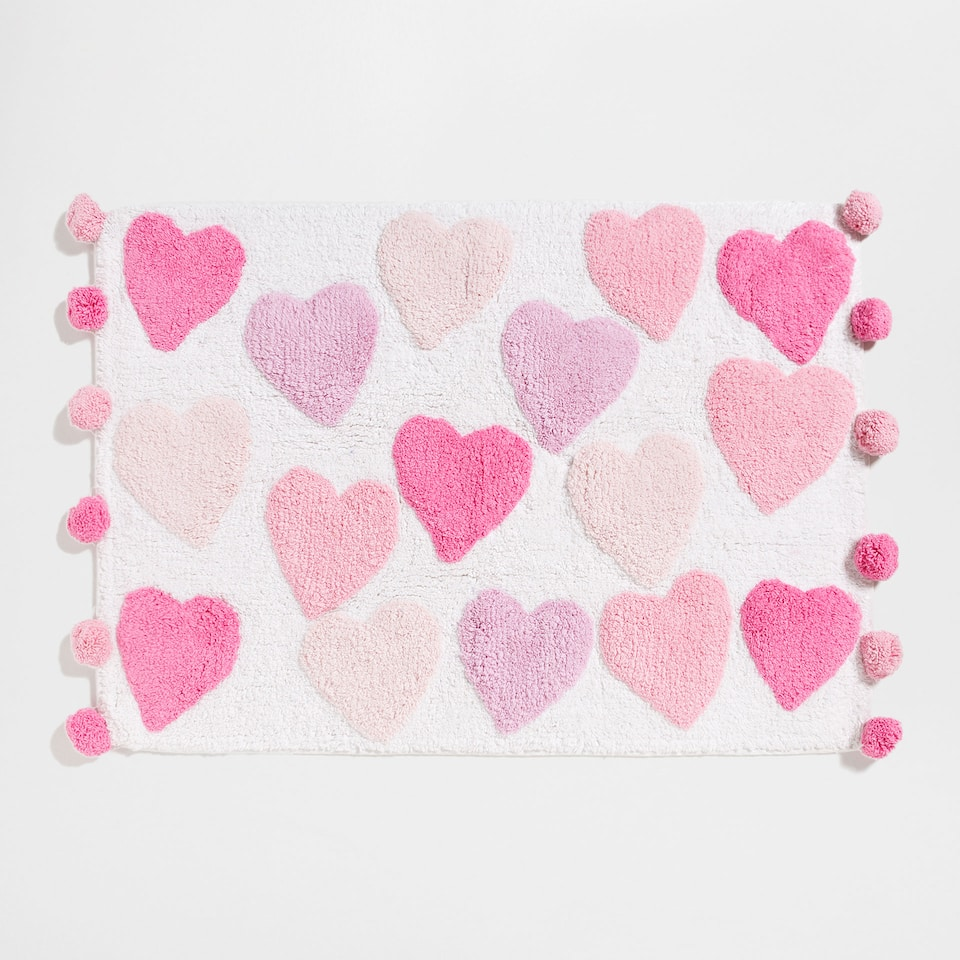 Hearts and pompoms bath mat