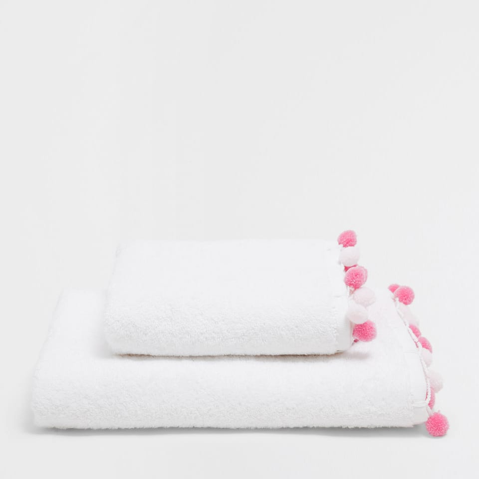Pink pompoms towel