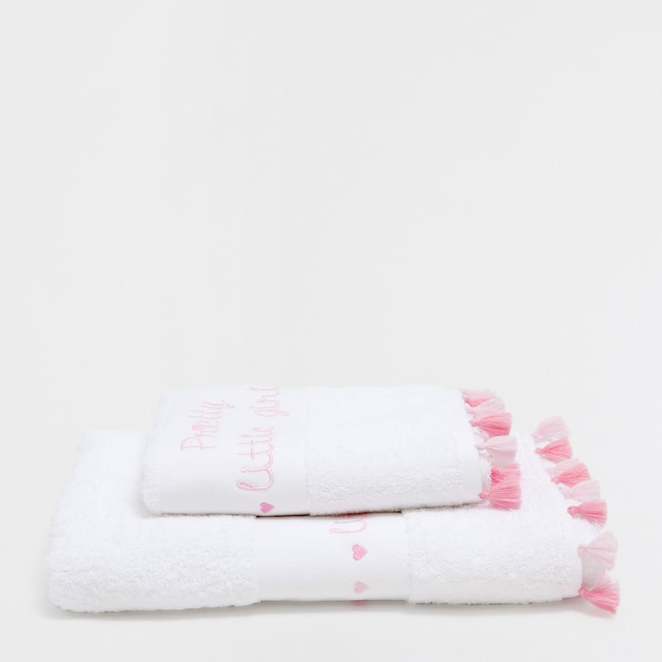 Embroidered text and pompoms cotton towel
