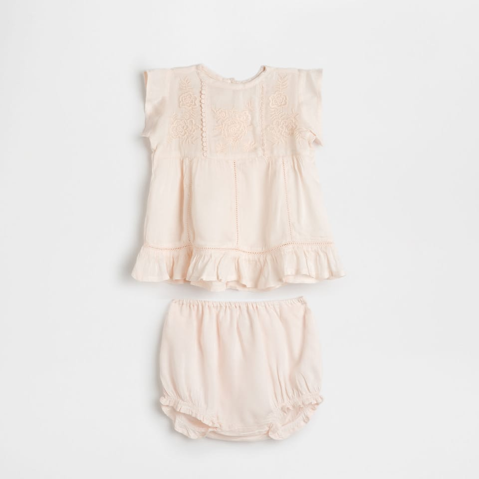 Peach-coloured embroidered baby set