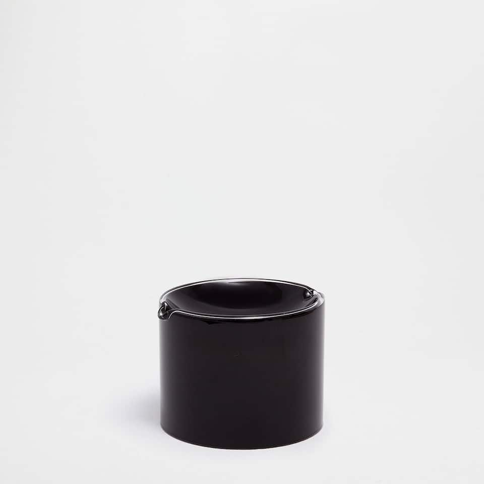 Black cylindrical glass ashtray