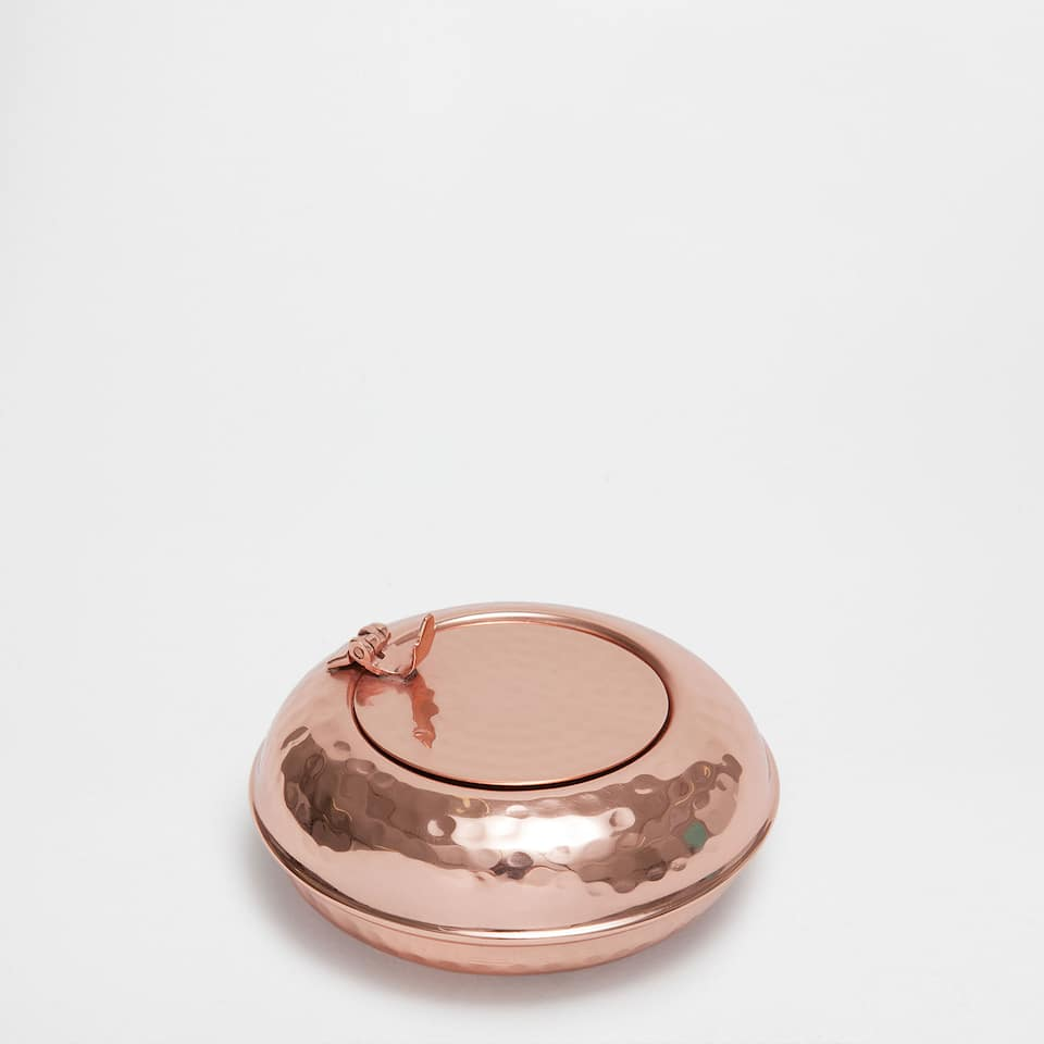 Copper-coloured hammered ashtray