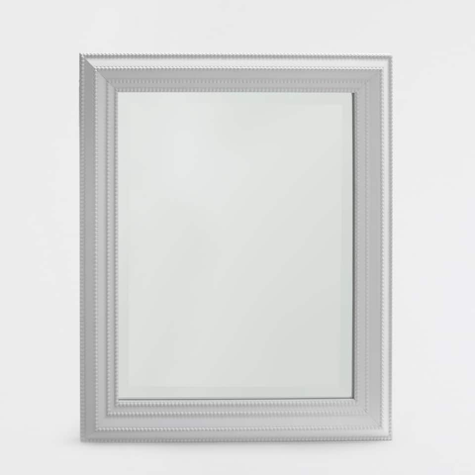 White rectangular mirror with a raised pattern