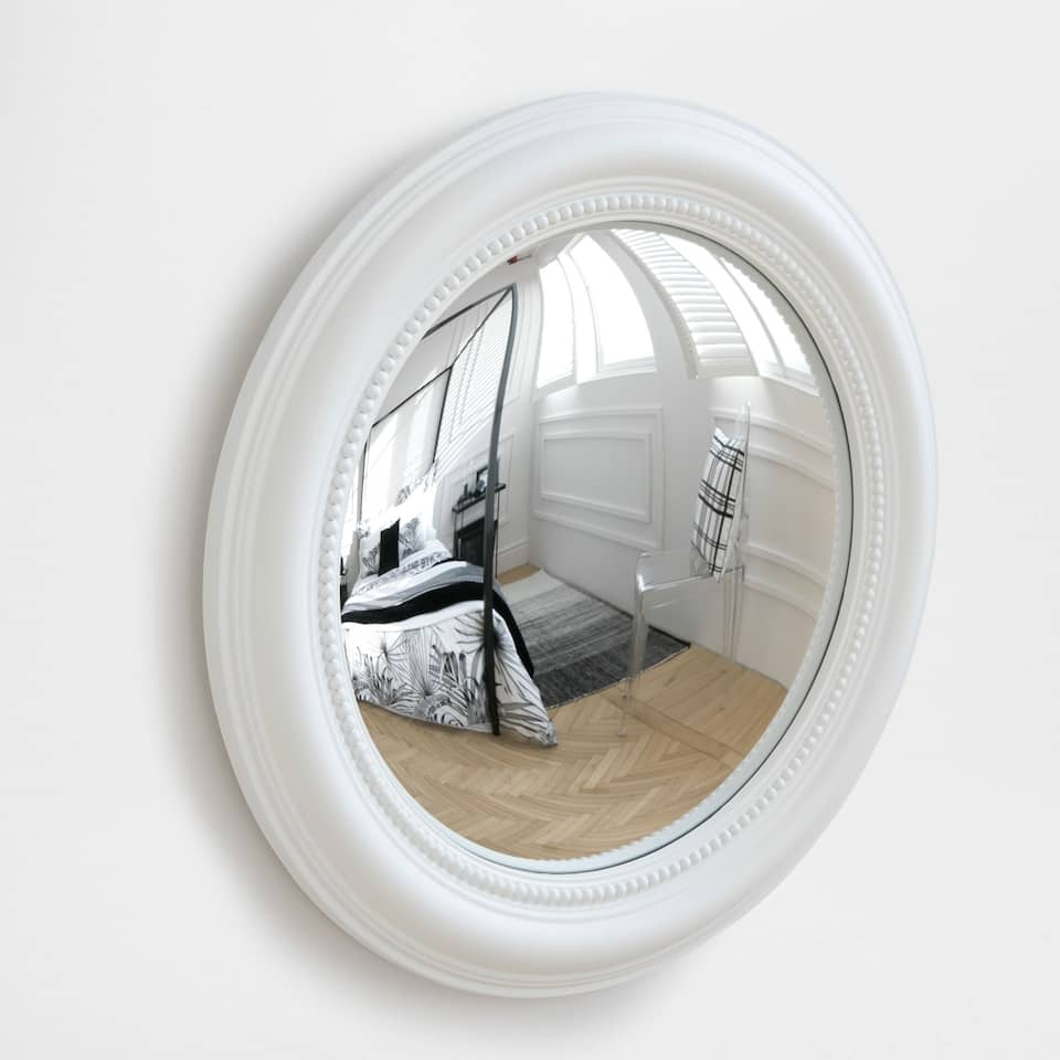 White concave mirror with a raised pattern