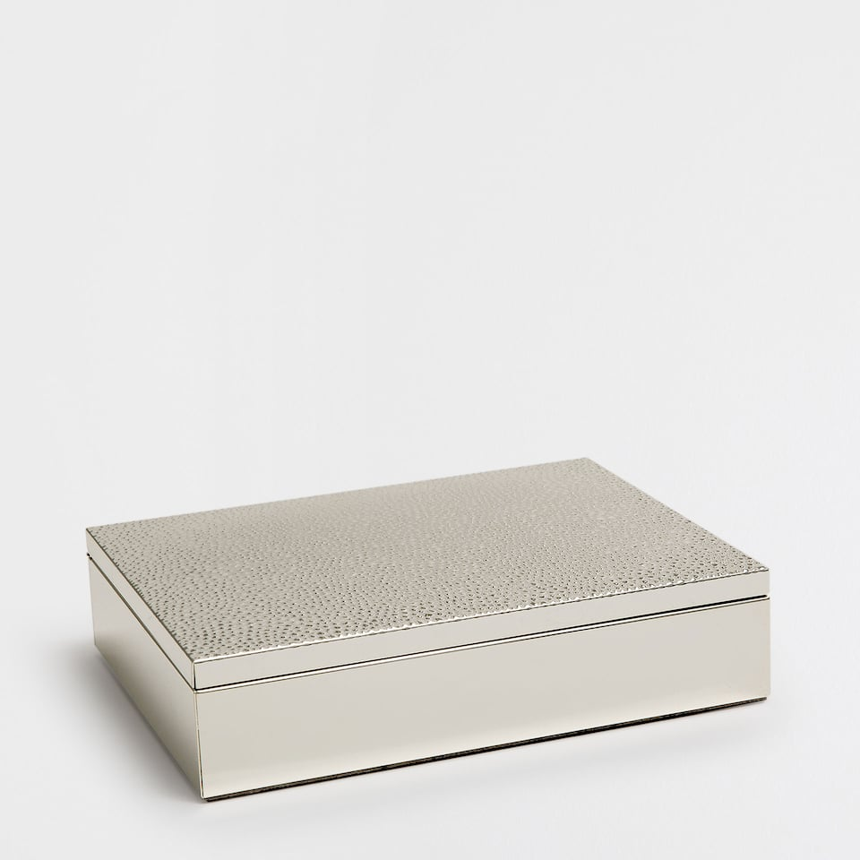 Silver metallic jewellery box with raised dots