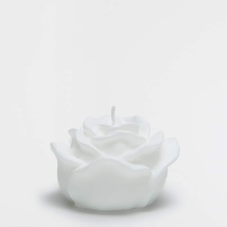 White flower-shaped candle