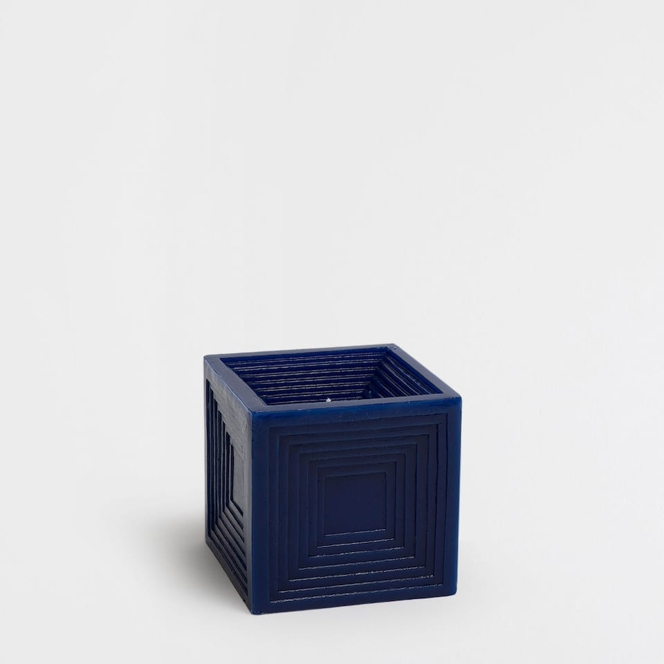 Blue cube-shaped candle