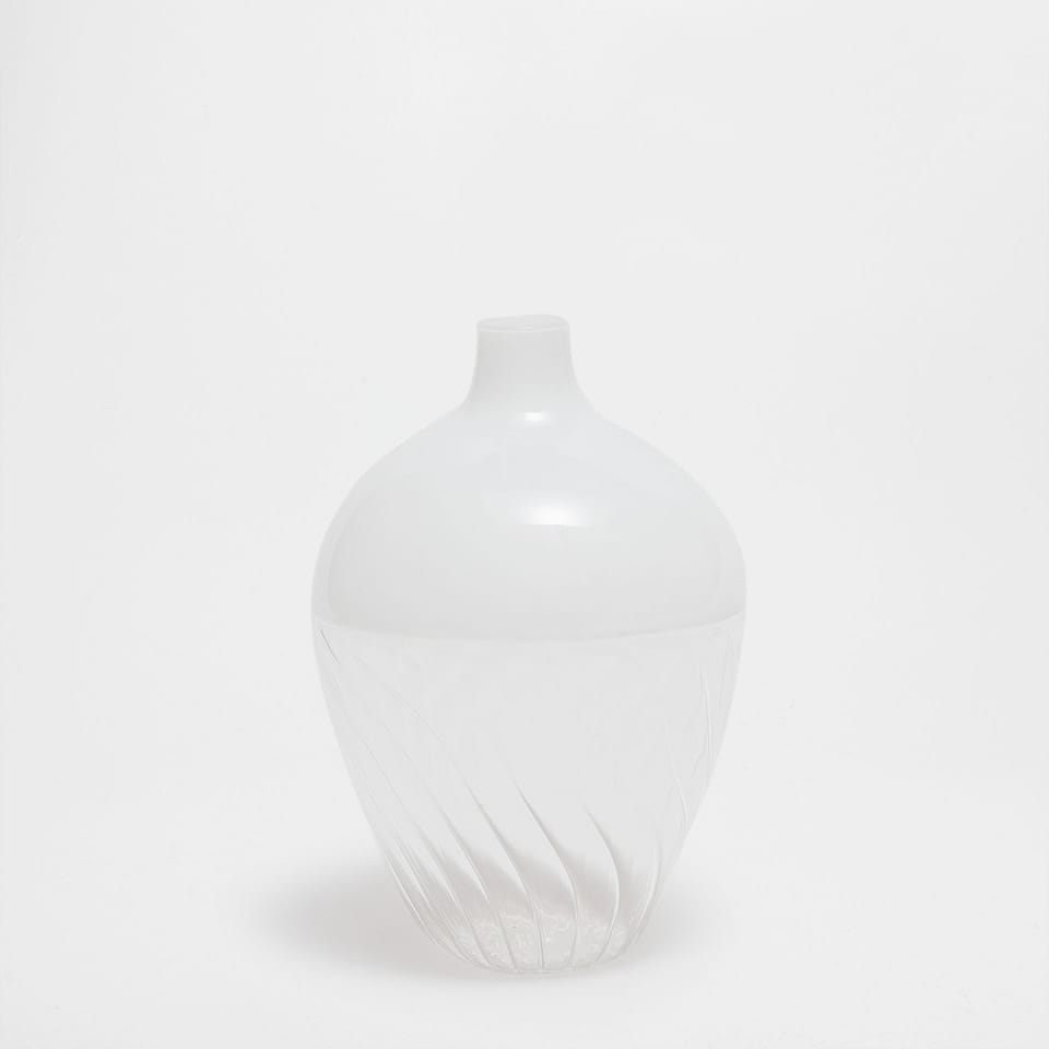 WHITE GLASS VASE WITH A RAISED PATTERN