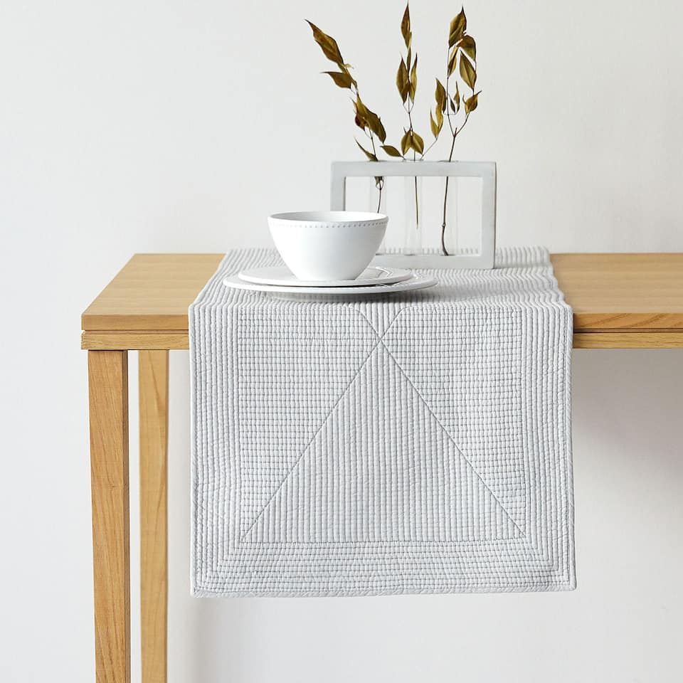 Grey quilted cotton table runner