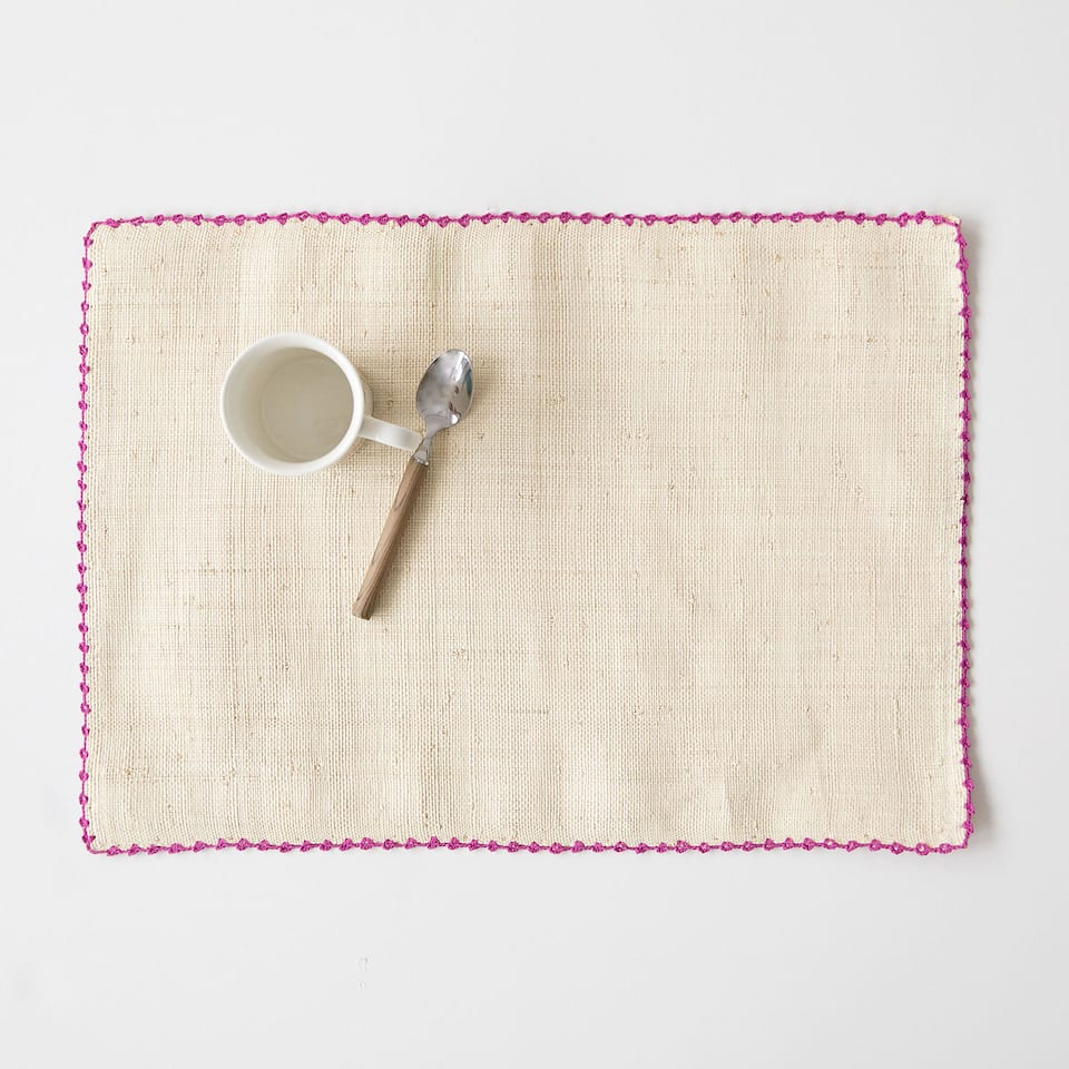 Embroidered raffia placemat