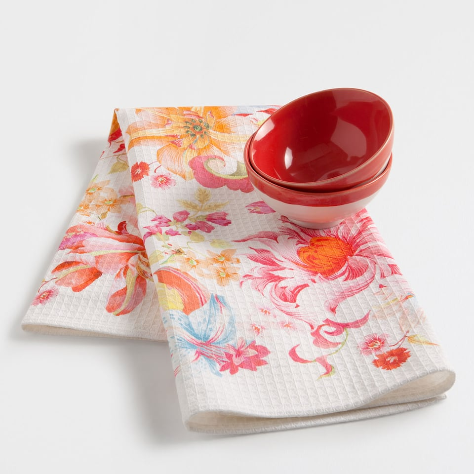 Smocked red floral cotton tea towel