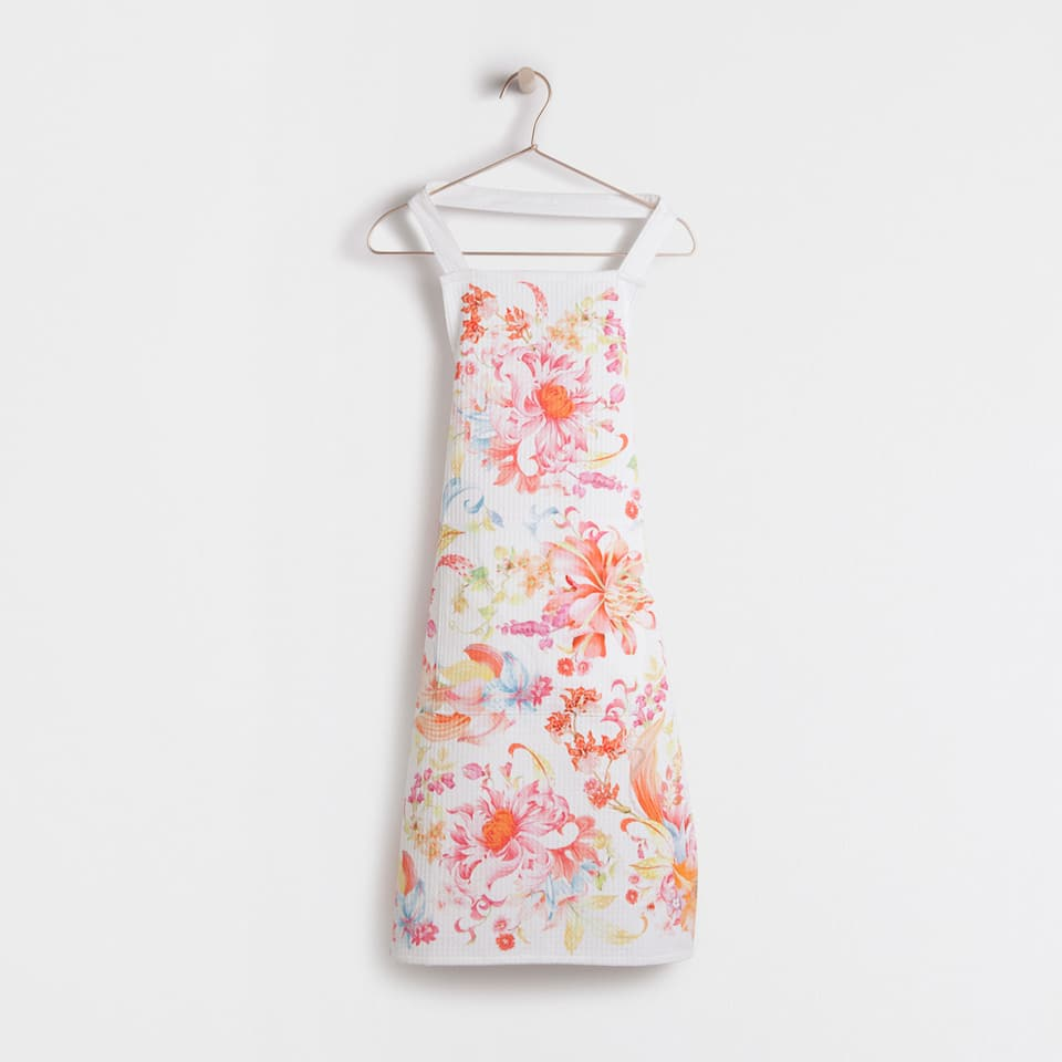 Reddish smocked floral cotton full-length apron