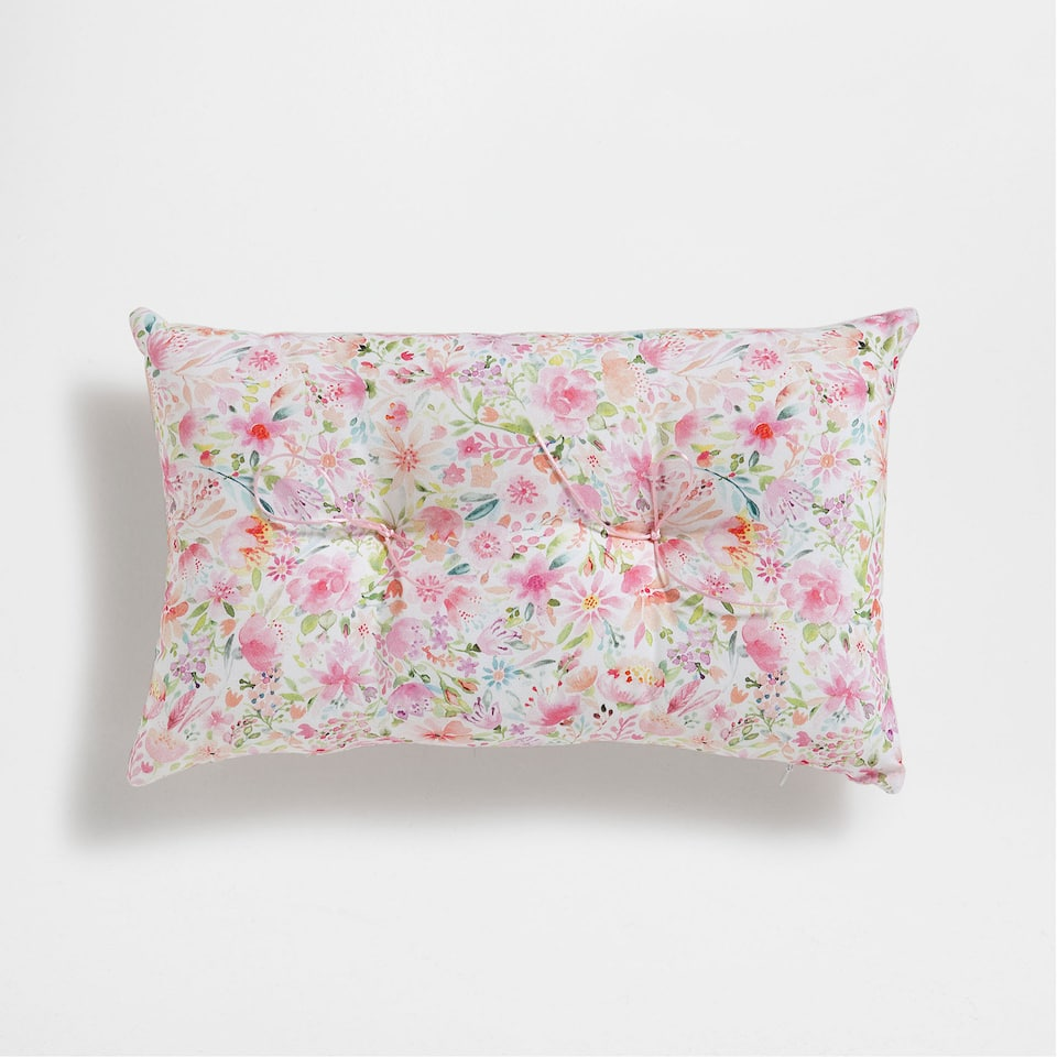 Floral printed upholstered cushion