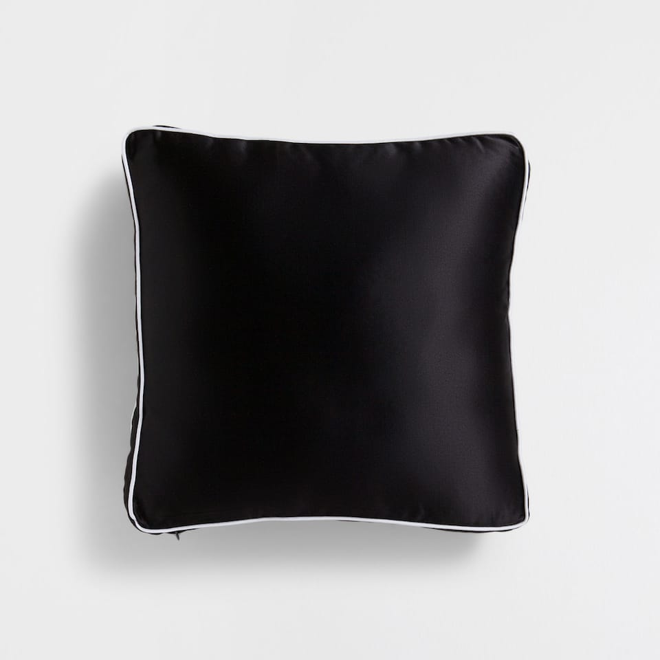 Cushion with contrasting edging