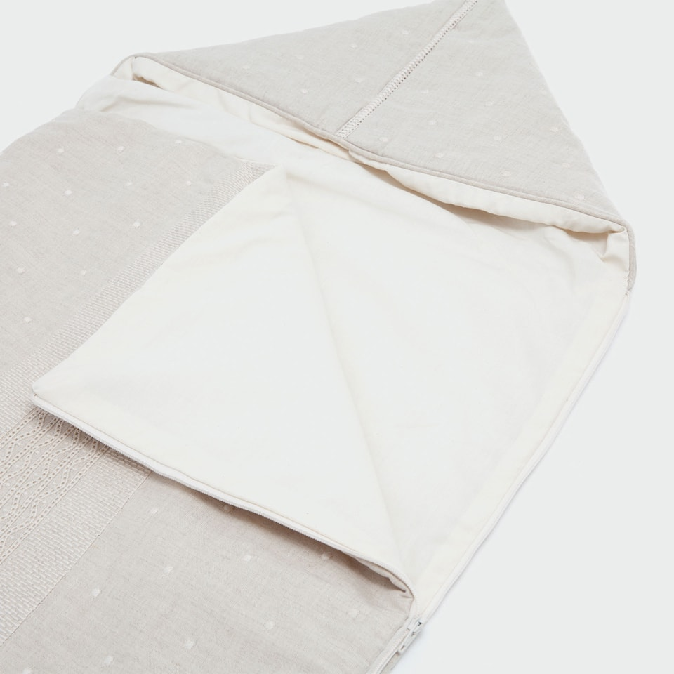 Tan embroidered cotton and linen sleeping bag