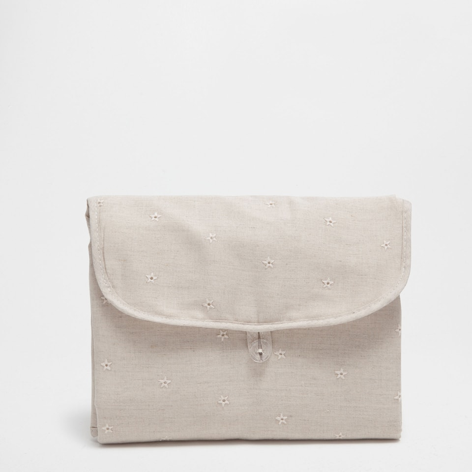 Tan embroidered cotton and linen changing mat